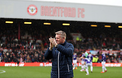 Brentford manager Dean Smith applauds the fans prior to kick-off during the Sky Bet Championship match at Griffin Park, London.