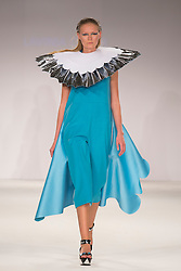 © Licensed to London News Pictures. 01/06/2014. London, England. Collection by Lavinia Cadar from UCA Epsom Fashion - university for the creative arts. Graduate Fashion Week 2014, Runway Show at the Old Truman Brewery in London, United Kingdom. Photo credit: Bettina Strenske/LNP