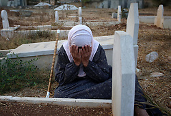 September 1, 2017 - Nablus, West Bank, Palestinian Territory - A Palestinian woman visits the grave of her relative at a cemetery on the first day of Eid al-Adha, or feast of the sacrifice, in the West Bank village of Lubban Ash-Sharqiya near Nablus. Muslims around the world are celebrating Eid al-Adha, the ''Feast of Sacrifice'', which marks the end of the annual pilgrimage or hajj to the Saudi holy city of Mecca and in remembrance of Abraham's readiness to sacrifice his son to God.  (Credit Image: © Ayman Ameen/APA Images via ZUMA Wire)