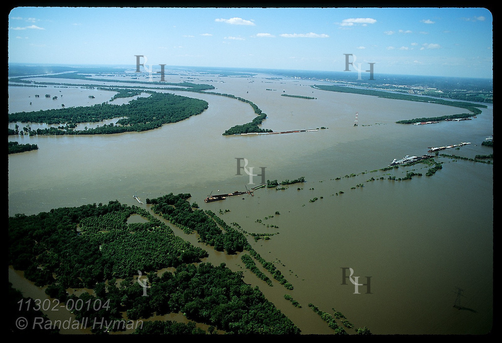 Aerial view of confluence of Missouri (left) & Mississippi Rivrs day after record crest of 8/1/93 Illinois