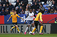 Southend United defender Jason Demetriou(left) and Bolton Wanderers Joe Dodoo in action during the EFL Sky Bet League 1 match between Bolton Wanderers and Southend United at the University of  Bolton Stadium, Bolton, England on 21 December 2019.