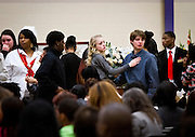 Friends and family look away after the viewing during the funeral for Tony Robinson, Jr. at Madison East High School in Madison, Wisconsin, Saturday, March 14, 2015. Hundreds of people gathered on Saturday for the funeral of a 19-year-old man killed by a police officer in Wisconsin's capital on March 6, a shooting that prompted protests over law enforcement's treatment of minorities.  REUTERS/Ben Brewer (UNITED STATES)