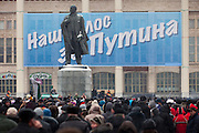 """Moscow, Russia, 23/02/2012..A statue of Lenin with a banner behind reading """"Our voice is for Putin"""" as some 130,000 people attend a rally at Luzhniki sports stadium supporting Prime Minister Vladimir Putin's presidential election campaign."""