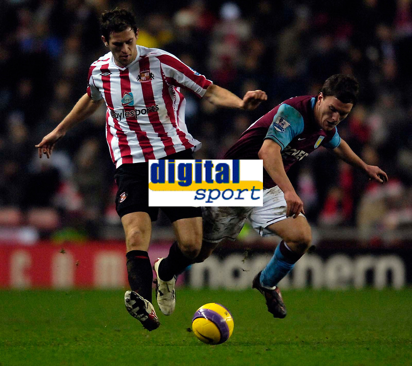 Photo: Jed Wee/Sportsbeat Images.<br /> Sunderland v Aston Villa. The FA Barclays Premiership. 15/12/2007.<br /> <br /> Sunderland's Daryl Murphy (L) stays strong as Aston Villa's Craig Gardner takes a tumble.