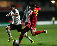 Pictured: Hal Robson-Kanu of Wales (R) takes a wide shot while closely marked by Emanuel Pogatetz of Austria (L).  Wednesday 06 February 2013..Re: Vauxhall International Friendly, Wales v Austria at the Liberty Stadium, Swansea, south Wales.