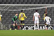 Milton Keynes Dons striker Kieran Agard (14) scores a goal from open play 1-0 during the EFL Trophy match between Milton Keynes Dons and Coventry City at Stadium:MK, Milton Keynes, England on 3 December 2019.