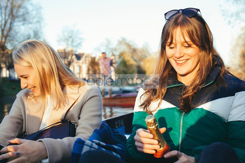 Women Having Fun on a Punt Boat in Cambridge, England, United Kingdom
