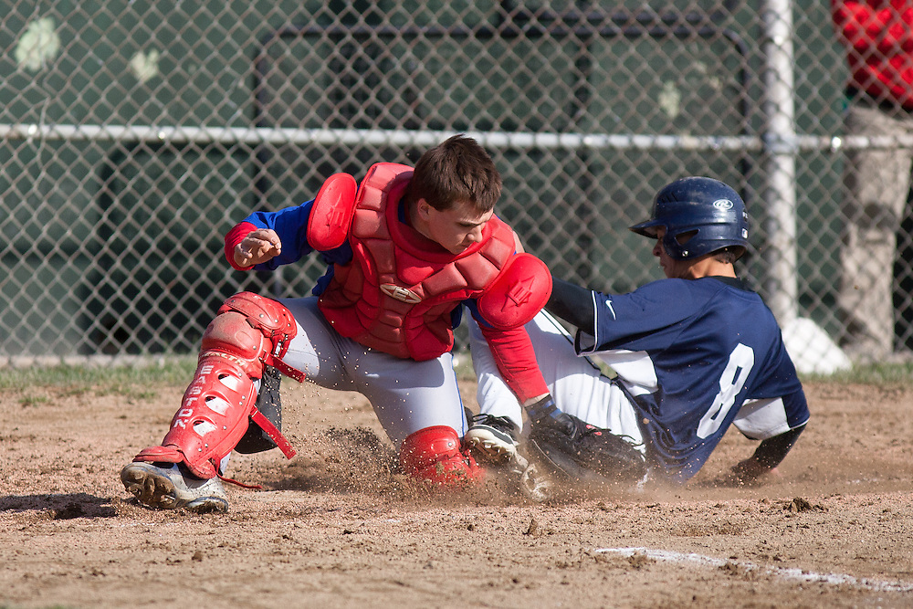 Somerville, MA 04/24/2012.Somerville's Quinton Hawkins tags Medford's Mike Khoury out at home during Tuesday's game.