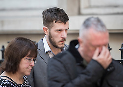 © Licensed to London News Pictures.11/04/2017.London, UK. CHRIS GARD leaves The Royal Courts of Justice in London after a High Court judge ruled that doctors can withdraw life-support treatment to his son, Charlie, who suffers from a rare genetic condition. Doctors at Great Ormond Street Hospital in London say eight-month-old Charlie should be left to die in dignity, but his parents have raised £1.2 million for specialist treatment in America. Photo credit: Peter Macdiarmid/LNP