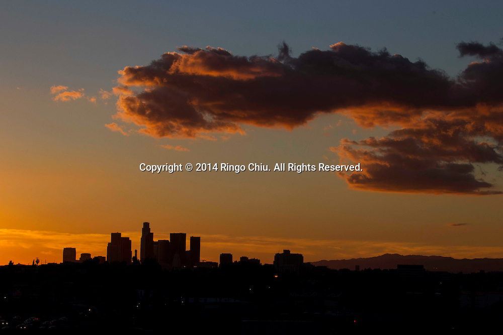 A glowing sunset provides a vibrant background for a dramatic cloud filled the sky overthe downtown Los Angeles is silhouetted on Monday Feburary 3, 2014. Los Angeles enjoyed warm winter while east coast fought cold weather.(Photo by Ringo Chiu/PHOTOFORMULA.com)