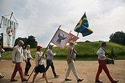 Members of an order celebrating the life and death of St Knut Lavard in Landskrona, Sweden 20th of August 2016. After having gathered in the court yard and a toast the order march out into the castles ground for traditional Swedish hot dogs and a game of bow and arrow. Saint Knut Lavard was killed in 1131 and celebrations were banned in 1415 across the Danish kingdom which covered Denmark and big parts of Sweden. The celebrations were allowed to continue in 1944 and several times a year people gather in Landskrona to comemorate St Knut lavard.