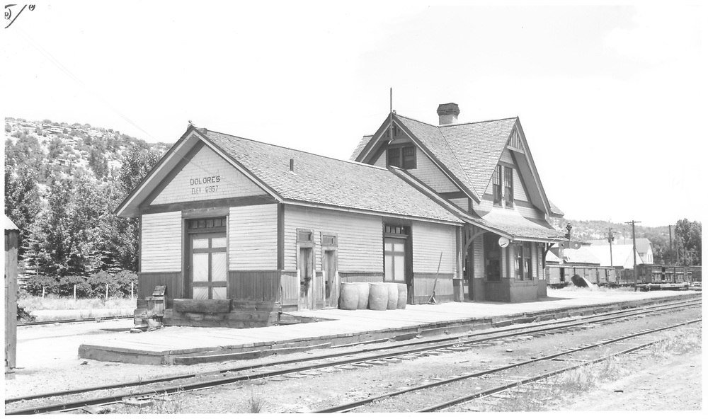 """View of RGS Dolores depot showing the new restroom doors which had been recently added.<br /> RGS  Dolores, CO  Taken by Jackson, Richard B. - 7/17/1941<br /> In book """"RGS Story, The Vol. VII: Dolores and McPhee"""" page 142"""
