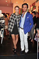 AMBER ATHERTON and MARK VANDELLI at the opening of the Kate Spade New York Store, 2 Symons Street, London on 1st September 2011.
