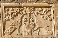 Detailed carving of 2 peacocks on the facade of Saint Marks Basilica Venice