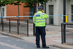 © Licensed to London News Pictures. 26/08/2018. London, UK. The scene on Creek Road in Deptford, south London, where a young man has been stabbed to death. Photo credit: Rob Pinney/LNP