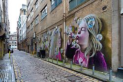 Street art mural in alleyway in  Glasgow City Centre, Scotland, UK