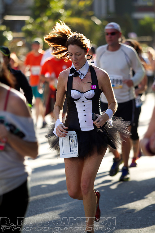 A costumed woman runs along Fell Street during the 102nd Bay to Breakers 12K in San Francisco, Sunday, May 19, 2013. More than 30,000 runners -- from the elite to the weekend warrior -- made the 7.62-mile trek from Howard and Spear to the Great Highway. (Photo by D. Ross Cameron)
