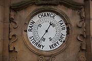 Barometer in Birmingham, England, United Kingdom. A barometer is a scientific instrument used in meteorology to measure atmospheric pressure. Pressure tendency can forecast short term changes in the weather.