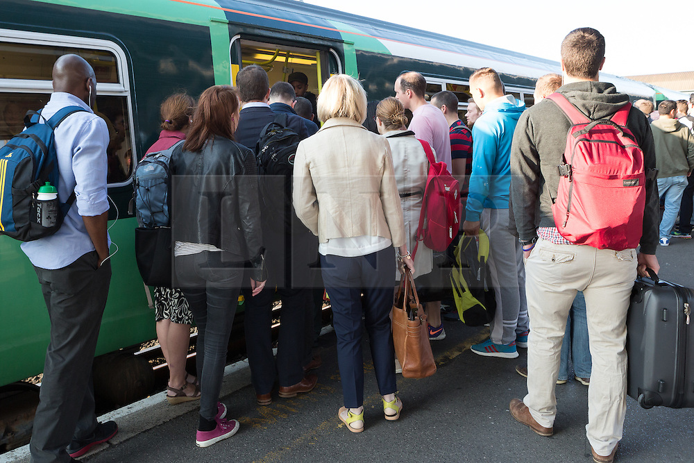 © Licensed to London News Pictures. 09/07/2015. London, UK. People try to board a train at Clapham Junction station in south London. A tube strike today has closed the TfL London Underground network and has been called by Trade Unions in protest over the new all-night tube trains, due to start in mid-September.. Photo credit : Vickie Flores/LNP
