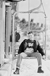 Man enjoying a ride on a ski lift