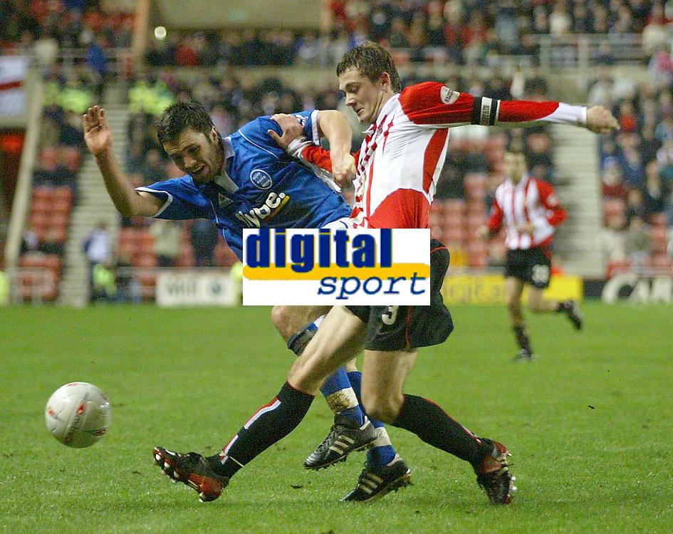 Photo. Andrew Unwin.<br /> Sunderland v Birmingham City, FA Cup Fifth Round, Stadium of Light, Sunderland 14/02/2004.<br /> Sunderland's George McCartney (r) tussles with Birmingham's Damien Johnson (l).