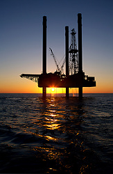 Stock photo of a jack up drilling rig on the Gulf Of Mexico
