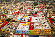 SHOT 2/18/19 6:07:20 PM - Aerial view of brightly colored homes in the historic city center of Campeche, Mexico. Campeche was founded in 1540 by Spanish conquistadores as San Francisco de Campeche and the city retains many of the old colonial Spanish city walls and fortifications which protected the city, not always successfully, from pirates and buccaneers and is known for its many colorfully painted homes in the historic city center. (Photo by Marc Piscotty / © 2019)