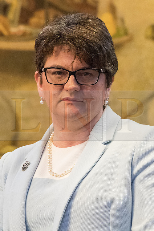 © Licensed to London News Pictures  . 03/10/2017 . Manchester , UK . ARLENE FOSTER MLA , leader of the Democratic Unionist Party ( DUP ) in front of The Proclamation Regarding Weights and Measures mural by Ford Madox Brown at a fringe event in the Great Hall in Manchester Town Hall during day three of the Conservative Party Conference at the Manchester Central Convention Centre . Photo credit : Joel Goodman/LNP