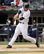 CHICAGO - APRIL 06:  Conor Gillaspie #12 of the Chicago White Sox hits a triple in the fifth inning against the Seattle Mariners on April 06, 2013 at U.S. Cellular Field in Chicago, Illinois.  The White Sox defeated the Mariners 4-3.  (Photo by Ron Vesely)   Subject:  Conor Gillaspie