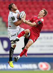 Scarlets' Liam Williams (right) and RC Toulon's Duane Vermeulen battle for the ball during the European Champions Cup, pool three mach at Parc y Scarlets, Llanelli.