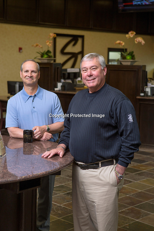 Danny Lewis, left, and Gary Head with Signature Bank stand in the lobby on Monday, April 6, 2015, in Fayetteville, Ark. Photo by Beth Hall