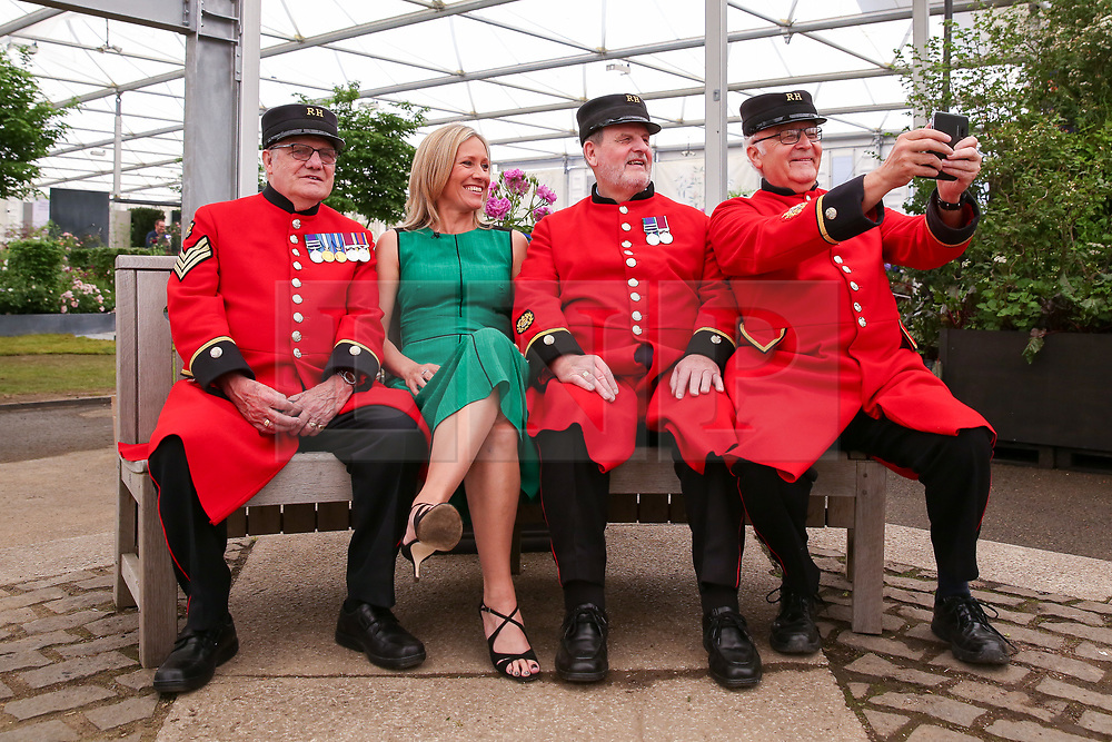 © Licensed to London News Pictures. 20/05/2019. London, UK. Chelsea Pensioners takes a selfie with Sophie Raworth. <br /> The Royal Horticultural Society Chelsea Flower Show is an annual garden show held over five days in the grounds of the Royal Hospital Chelsea in West London. The show is open to the public from 21 May until 25 May 2019. Photo credit: Dinendra Haria/LNP