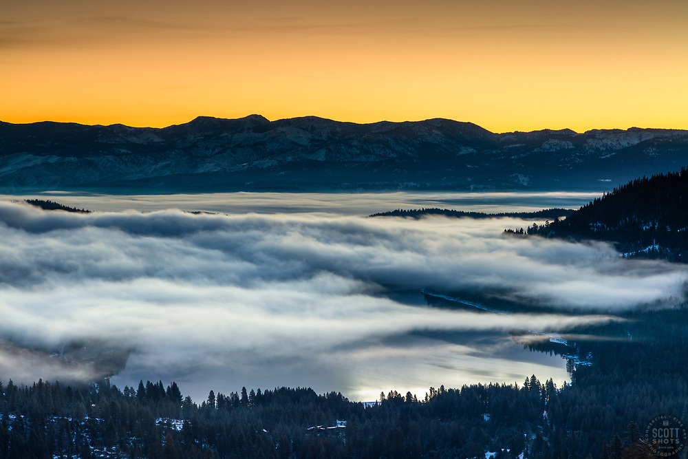 """""""Donner Lake Sunrise 20"""" - Photograph of the colorful sunrise above Donner Lake with a cloudy inversion layer above the lake."""