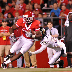 Sep 19, 2009; Piscataway, NJ, USA; Rutgers wide receiver Mohamed Sanu (6) runs past Florida International cornerback Peter Riley (39) after a reception during the second half of Rutgers' 23-15 victory over Florida International at Rutgers Stadium.