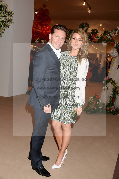 NICK CANDY and HOLLY VALANCE at the Masterpiece Midsummer Party in aid of Marie Curie Cancer Care held at The Royal Hospital Chelsea, London on 2nd July 2013.