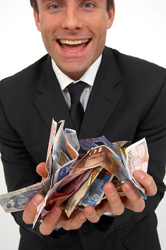 man with hands full of cash<br />