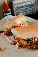 """Photography of fhe """"Surf & Turf"""" poboy at Parkway Bakery in New Orleans, LA."""
