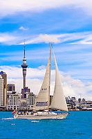 """The """"Pride of Auckland"""" sailboat with the Auckland skyline behind, featuring the 328 meter high Sky Tower (the tallest free-standing structure in the Southern Hemisphere), Auckland, New Zealand"""