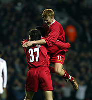 Fotball: Liverpool John Arne Riise (top) celebrates with goalscorers Jari Litmanen and Emile Heskey (hidden)  during the UEFA Champions League match at Anfield.<br />Tuesday March 19th 2002. Liverpool v Roma.<br />Foto: David Rawcliffe, Digitalsport