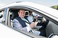 17 JUL 2018, GIFHORN/GERMANY:<br /> Hubertus Heil (L), SPD, Bundesminister fuer Arbeit und Soziales, steuert einen PKW mit einem iPad, waehrend dem Besuch der Ingenieurgesellschaft Auto und Verkehr, IAV, im Rahmen seiner Sommerreise<br /> IMAGE: 20180717-01-014