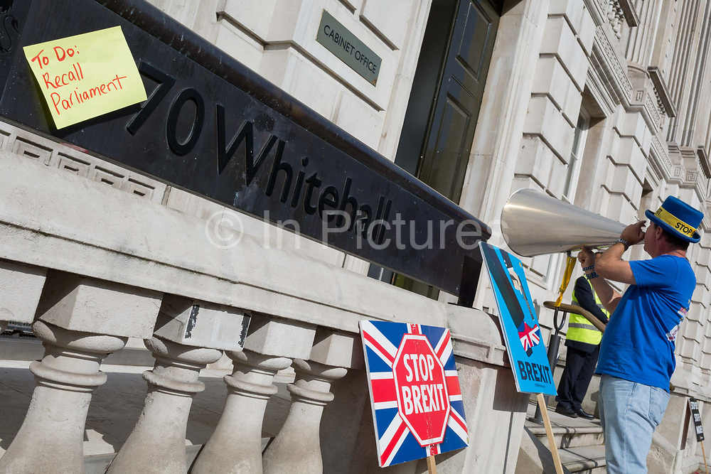 Renowned Brexit protester Steve Bray shouts Remain chants into the doors of the Cabinet Office on Whitehall, the location of daily Brexit contingency planning meetings codenamed Yellowhammer, in government departments, on 19th August 2019, in London, England.