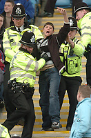 Photo: Leigh Quinnell.<br /> Coventry City v Preston North End. Coca Cola Championship. 01/04/2006. A coventry fan is shown the door by the police.