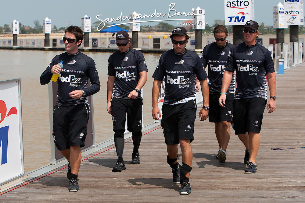 Adam Minoprio (NZL) with the ETNZ/Black Match Racing team walking on the pontoon towards lunch after a disappointing morning were they lost all their matches. Monsoon Cup 2009. Kuala Terengganu, Malaysia. 4 December 2009. Photo: Sander van der Borch / Subzero Images