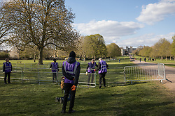 Windsor, UK. 16th April, 2021. Community wardens from the Royal Borough of Windsor and Maidenhead erect railings beside the Long Walk in Windsor Great Park on the eve of the funeral of the Duke of Edinburgh. The funeral of Prince Philip, Queen Elizabeth II's husband, will take place at St George's Chapel in Windsor Castle at 15:00 BST on 17th April.