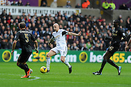 Swansea city's Jonjo Shelvey makes a break. Barclays Premier league, Swansea city v Manchester City at the Liberty Stadium in Swansea,  South Wales on  New years day Wed 1st Jan 2014 <br /> pic by Andrew Orchard, Andrew Orchard sports photography.