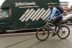 Young women cycling to work