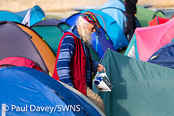 A man emerges from his tent as a new day begins as hundreds of environmental protesters from Extinction Rebellion occupy Marble Arch, camping in the square and even on the streets, blocking access to traffic on Park Lane and Oxford Street in London's usually traffic-heavy west end. . London, April 16 2019.
