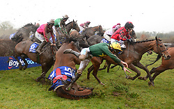 Jockey Brian Hayes on board The Paparrazi Kid falls over a hurdle, both ok afterwards, in the Boylesports Irish Grand National Chase, during BoyleSports Irish Grand National Day of the 2018 Easter Festival at Fairyhouse Racecourse, Ratoath, Co. Meath.