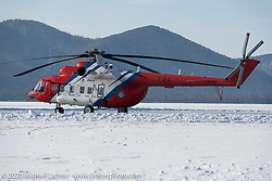 A giant Russian Mi8 helicopter (manufactured just a few hours away in Ulan-Ude) was on hand to make runs against the land based racers. Baikal Mile Ice Speed Festival. Maksimiha, Siberia, Russia. Friday, February 28, 2020. Photography ©2020 Michael Lichter.