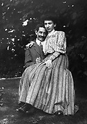 Young French married couple, sitting together in a Garden circa 1900